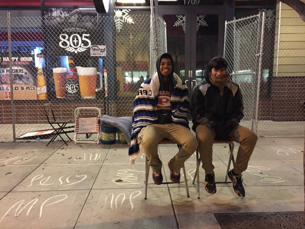 Pasadena High School seniors Max Perry and Jaylen Medina, both 17, turned out at about 4 a.m. on Wednesday, December 31, 2014 — more than a day early — to stake out a spot in front of Z Pizza on Colorado Boulevard to watch the Rose Parade in Pasadena.