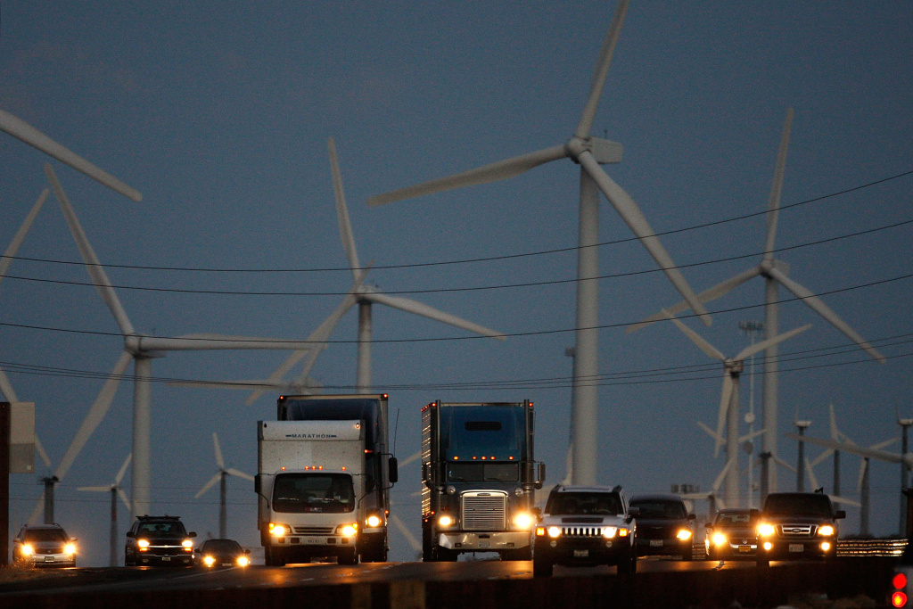 Emissions-producing diesel trucks and cars pass non-polluting windmills along the 10 freeway on December 8, 2009 near Banning, California. Sustained global warming shows no sign of letting up according to new analysis by the World Meteorological Organization made public at the climate talks in Copenhagen. Although global temperature fluctuates from year to year, overall the decade of the 2000s is likely the warmest decade in the past 150 years covered by the report. This decade is warmer than the 1990s which were warmer than the 1980s, and so on. The conclusion meshes with independent analysis by the National Climatic Data Center and NASA.