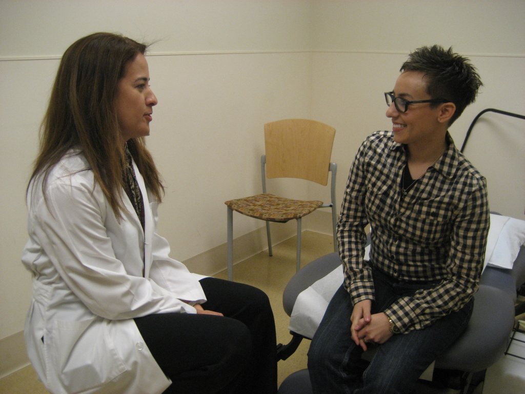 Carolina Martinez (right), a bladder pacemaker patient, talks with her doctor, urologist Larissa Rodriguez, in an exam room at UCLA. Martinez says the pacemaker has made a huge difference in her life.