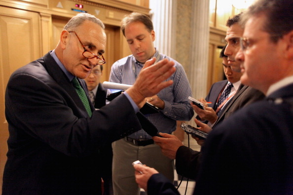 Sen. Charles Schumer (D-NY) talks with reporters after voting for President Barak Obama's America Jobs Act October 11, 2011 in Washington, DC.