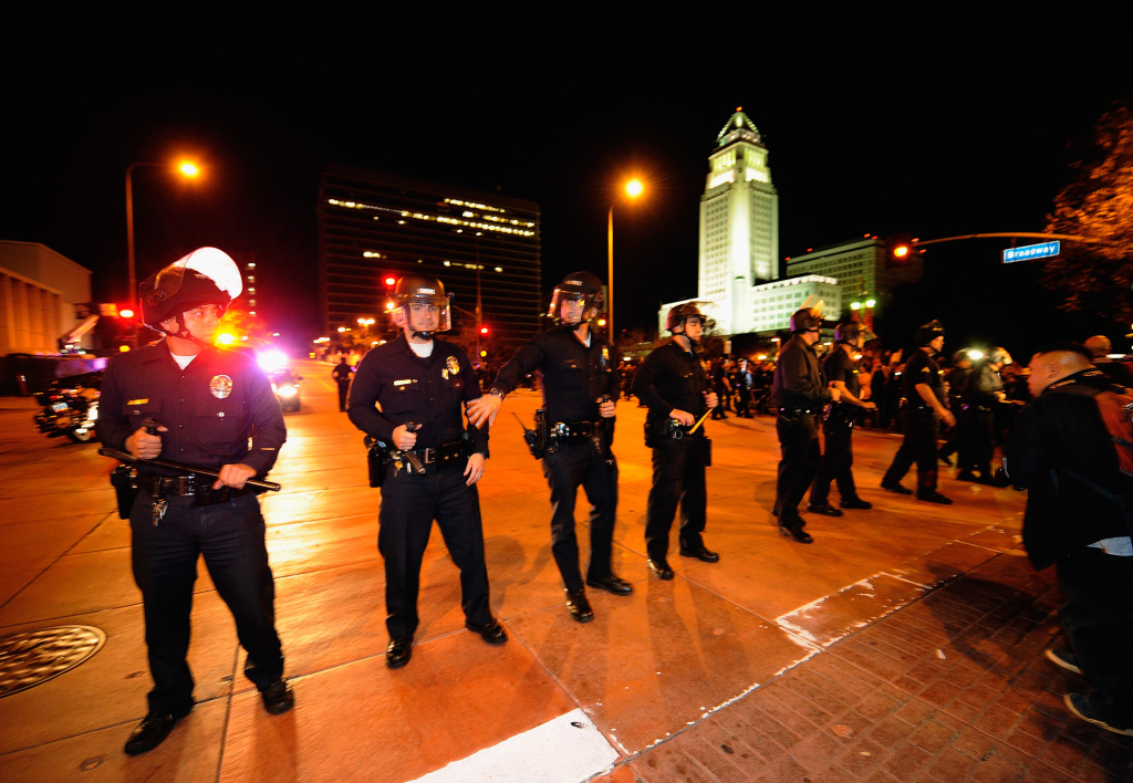 Los Angeles Police Officers in riot gear deploy around the Los Angeles City Hall after the deadline to dismantle the occupy campsite expired on Nov. 28, 2011, in Los Angeles, Calif.