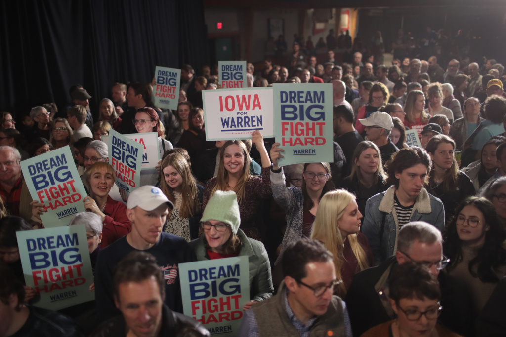 Guests wait for Democratic presidential candidate Sen. Elizabeth Warren (D-MA) to speak at a campaign stop on November 25, 2019 in West Des Moines, Iowa.