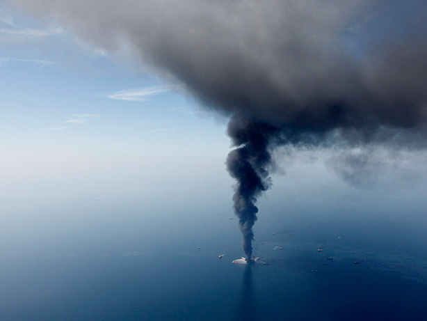 The Deepwater Horizon oil rig is seen burning on April 21 in the Gulf of Mexico. Federal investigators have turned their attention to the cementing process that occurred on the oil rig before the explosion.