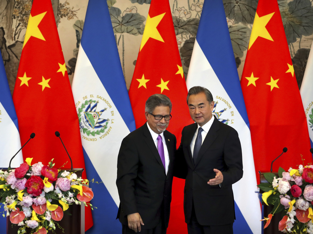 El Salvador's Foreign Minister Carlos Castaneda, left, and China's Foreign Minister Wang Yi stand together at a ceremony in Beijing to mark the beginning of diplomatic relations between the two countries on Tuesday. The move leaves Taiwan with one less ally.