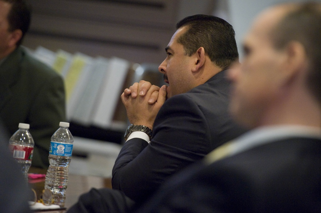 Defendant Manuel Ramos listens to closing arguments during his criminal trial.