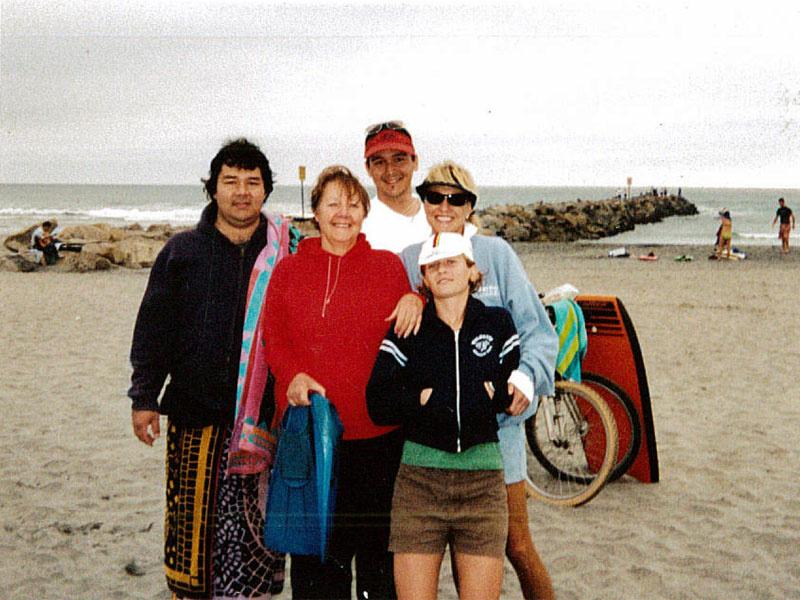 Jason Nishimoto (left) on the beach with his family.