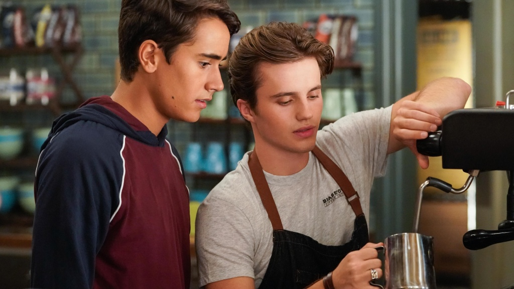 Espress yourself: Victor (Michael Cimino, left) bellies up to barista Benji (George Sear) in Hulu's <em>Love, Victor.</em>