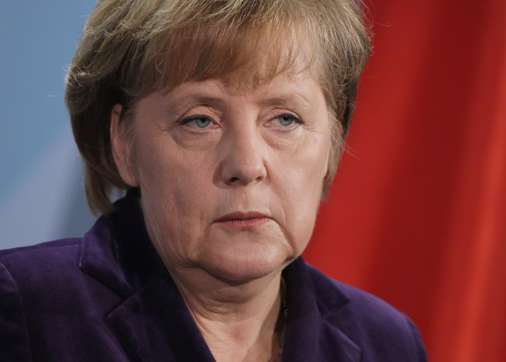 German Chancellor Angela Merkel speaks to the media following talks with French President Nicolas Sarkozy at the Chancellery on January 9, 2012 in Berlin, Germany. The two leaders discussed the ongoing Eurozone debt crisis as well as a possible European financial transaction tax, among other topics.  (