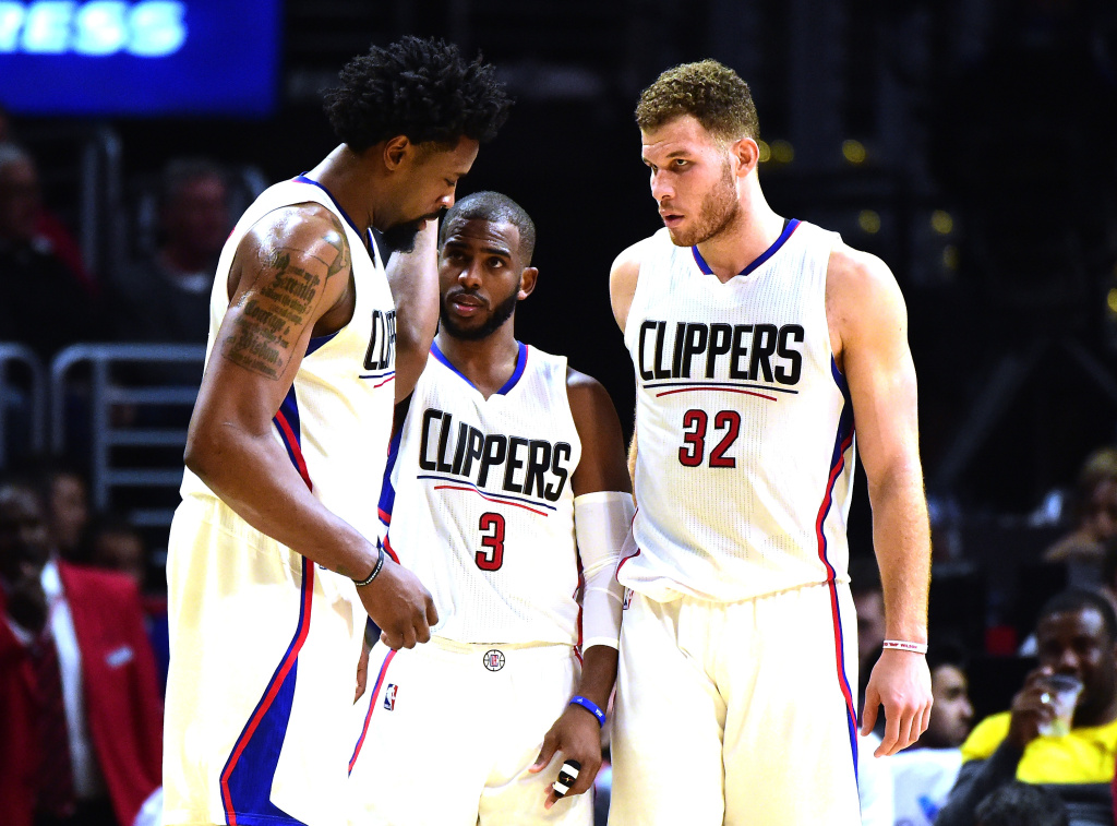 DeAndre Jordan #6, Chris Paul #3 and Blake Griffin #32 of the Los Angeles Clippers gather during the game against the Oklahoma City Thunder at Staples Center on December 21, 2015 in Los Angeles, California.