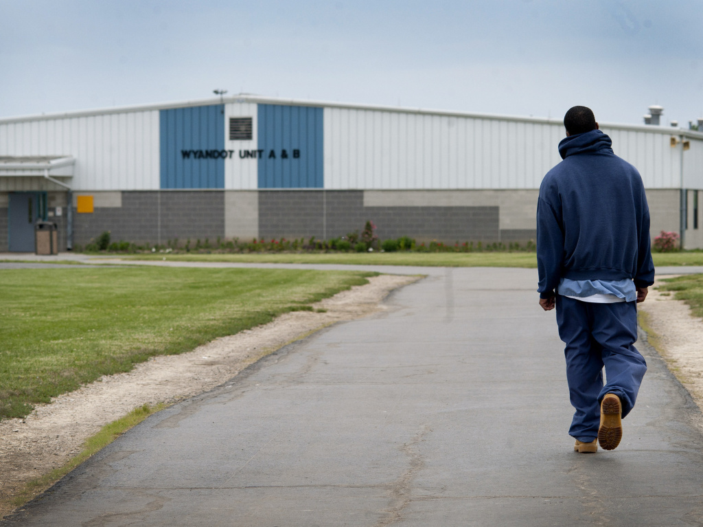 An inmate walks through the yard at the North Central Correctional Institution in Marion, Ohio, a privately run prison.