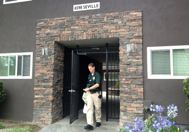 A crime scene investigator emerges from Elliot Rodger's apartment near UC Santa Barbara on the morning after his rampage. Sheriff's deputies conducted a mental health call on Rodger the previous month but found no cause to investigate further.