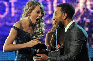 John Legend presents to Taylor Swift the award for the Best Album of the Year during the 52nd annual Grammy Awards in Los Angeles, California on January 31, 2010.