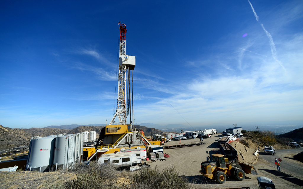 In this file photo, crews from SoCalGas and outside experts work on a relief well at the Aliso Canyon facility above Porter Ranch on Dec. 9, 2015. Gas has been spewing from the leak for three months. A legislative amendment would direct the Secretary of Energy to lead a review of the cause and response to the leak.
