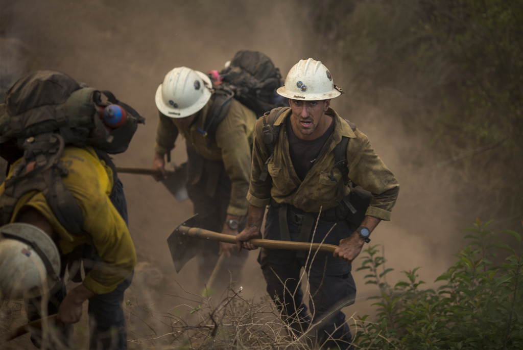 A Hot Shot crew cuts a line among homes at the Thomas Fire on December 16, 2017 in Montecito, California.