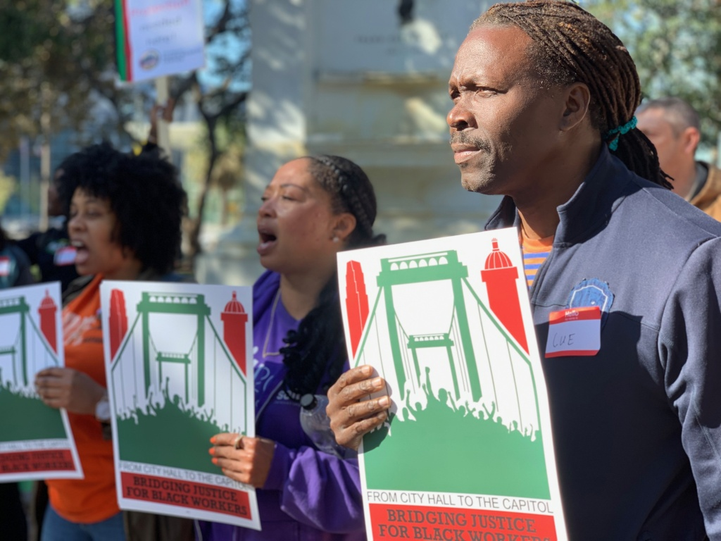 Workers with the L.A. Black Worker Center rally before the City Council vote establishing a civil rights commission.