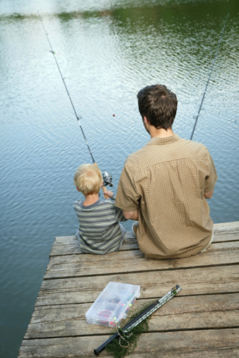 Stock photo of father and son fishing.