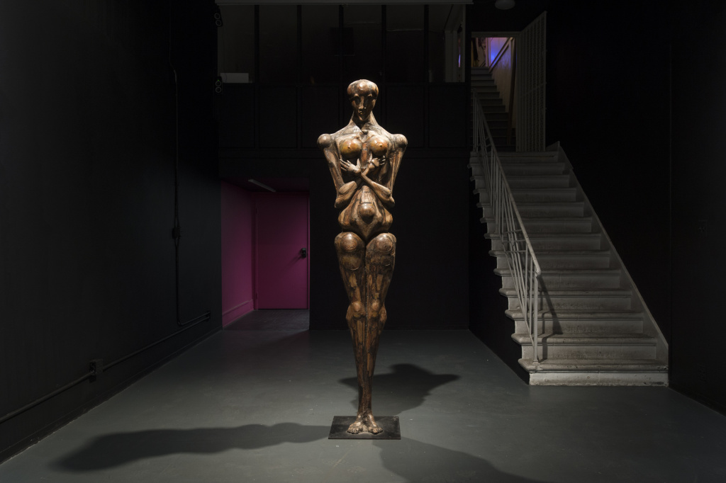 Maxine Kim Stussy: The Watcher, 1980, wood assemblage, height: 89 in.; metal base: 18 x 18 in. At