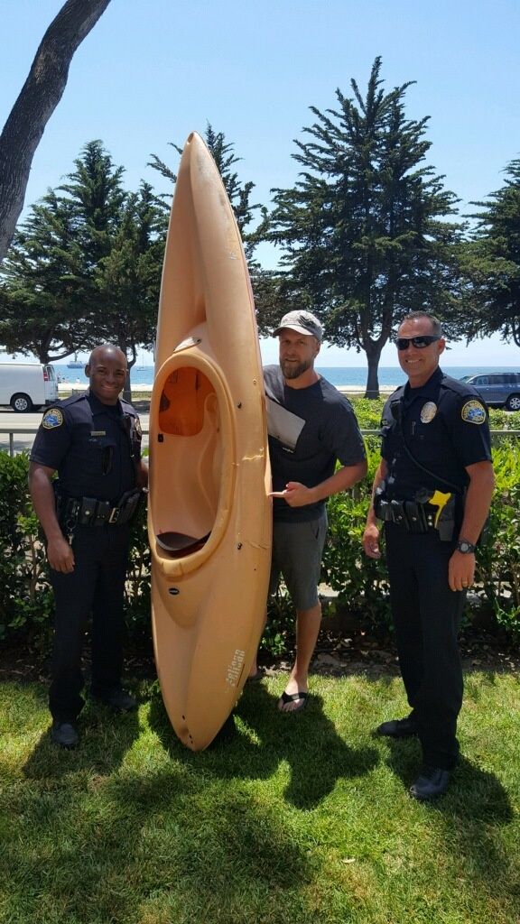 Bret Jackson poses with the kayak he was in during a shark attack near a Santa Barbara beach.