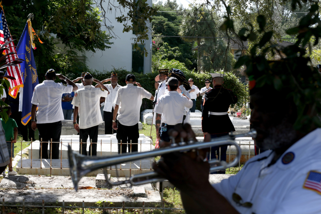 Cyril Bullard retired from the United States Army plays the trumpet during a Veterans Day ceremony at the Coconut Grove Bahamian cemetery on November 11, 2013 in Coconut Grove, Florida.