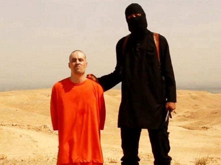 The masked man seen executing American journalist James Foley in a video is a member of the group calling itself the Islamic State and is believed to be from the U.K., based on his accent.