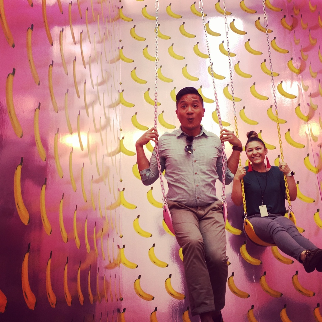 KPCC's Leo Duran (l) and Maya Sugarman take a pic on swings at the Museum of Ice Cream in Los Angeles.