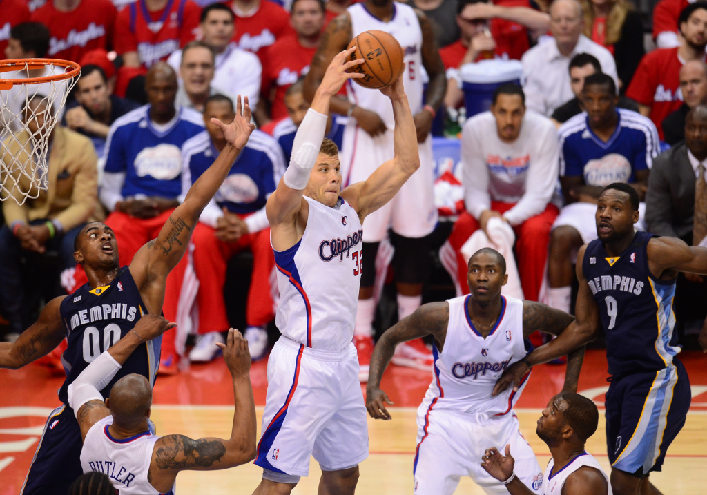 Blake Griffin (C) of the Los Angeles Clippers hauls in a rebound against the Memphis Grizzlies during game two of their NBA Basketball playoff series at Staples Center in Los Angeles, California on April 22, 2013.