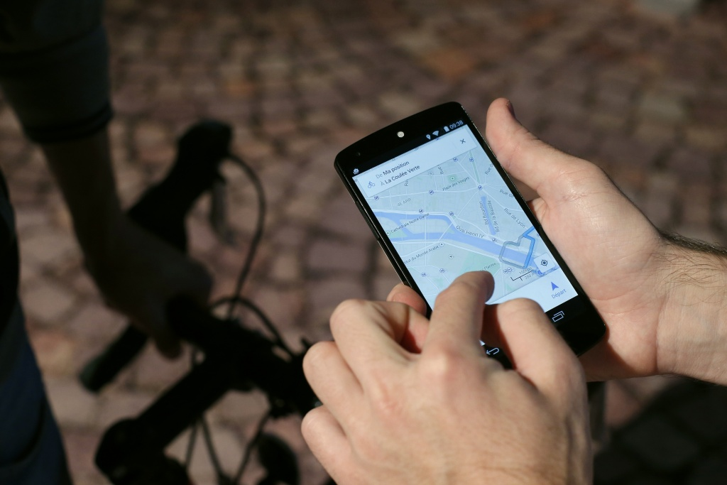 A man uses a GPS app on a smartphone