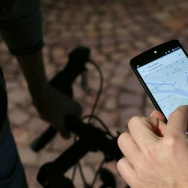 A man uses a GPS app on a smartphone during a Google promotion event at the City of Fashion and Design (Cite de la mode et du design) in Paris on November 4, 2014.