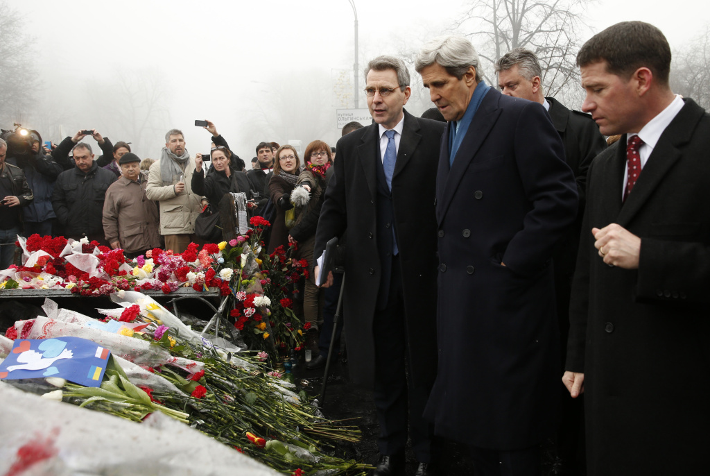 U.S. Secretary of State John Kerry (2nd R), flanked by US ambassador in Ukraine Geoffrey Pyatt (3rd L), stands at the Shrine of the Fallen in Kiev on March 4, 2014. The Shrine of the Fallen, located on Institutska Street, honors the fallen 'Heroes' of the 'Heavenly Sotnya' (Hundred). Over the course of the EuroMaidan protests, almost 100 protesters were killed by police. Most of them died on February 20 killed by sniper or automatic weapons fire on Institutska Street. US Secretary of State John Kerry arrived in Kiev Tuesday for talks with Ukraine's new interim government, amid an escalating crisis in Crimea. His visit came as the United States said it would provide $1 billion to financially-stricken Ukraine as part of an international loan. With the Black Sea peninsula of Crimea under near complete control by pro-Russian forces, US officials said Moscow could face sanctions within days.