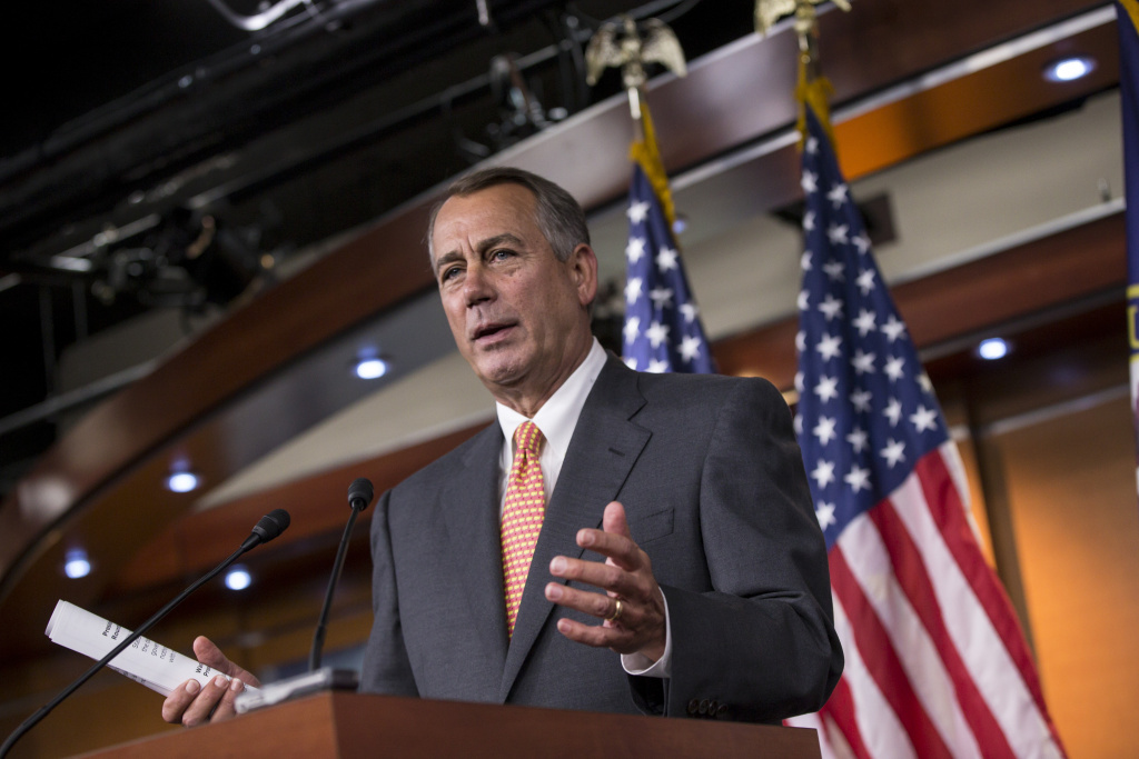Speaker of the House John Boehner, R-Ohio, talks to reporters about the deadline to fund the government and the fight among House Republicans, on Capitol Hill in Washington, Sept. 19, 2013. House Republicans vowed Wednesday to pass legislation that would prevent a partial government shutdown and avoid a default while simultaneously canceling out President Barack Obama's health care overhaul, inaugurating a new round of political brinkmanship as critical deadlines approach.