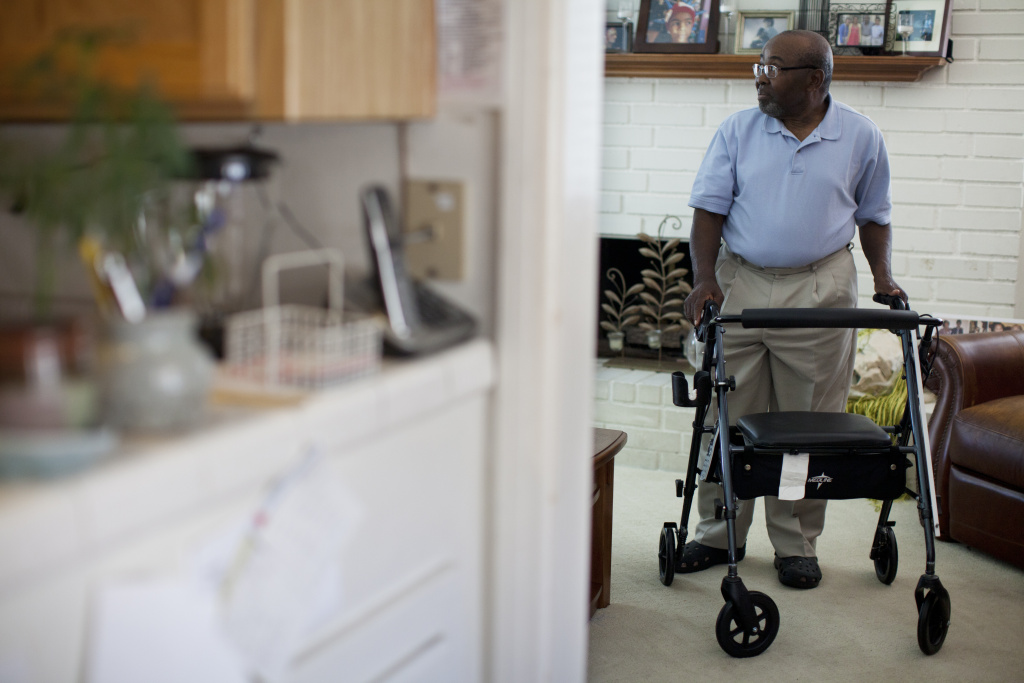 After two unnecessary back surgeries, Azike Ntephe now uses a walker to move around his home. He had to give up his law practice and most outdoor activities as begins to walk on his own again.