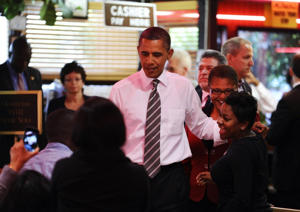 President Obama greets dinners at the Roscoe's Chicken and Waffles in Los Angeles on his October 24, 2011 visit.