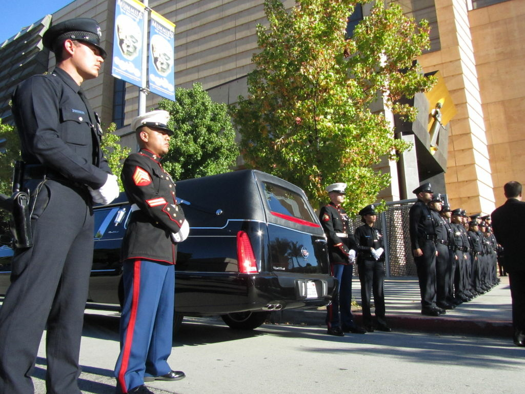 Hundreds of Los Angeles Police officers and United States Marines attended Joshua Cullins funeral at the Cathedral of Our Lady of the Angels downtown L.A. Temple Street was shut down during morning rush our to accommodate the funeral service.