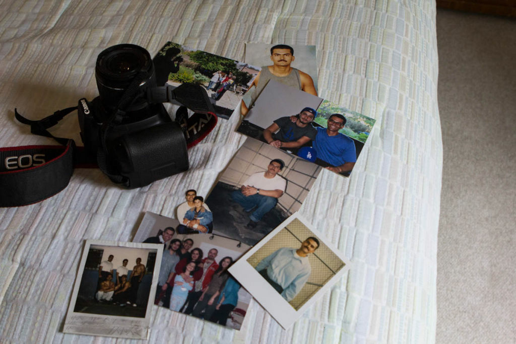 Photography has become one of Carrillo's favorite hobbies, as has sharing his photos on Facebook. He lays out his camera and some photos he collected of his time in prison and his release.