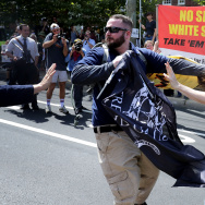"White nationalists, neo-Nazis and members of the ""alt-right"" clash with counter-protesters in the street after the ""Unite the Right"" rally was delcared a unlawful gathering by Virginia State Police August 12, 2017 in Charlottesville, Virginia."