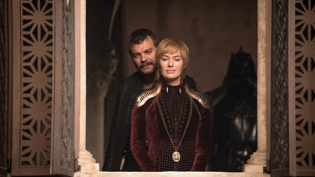 Boy, Mike Brady really let himself go, hunh?: Schemin' seaman Euron (Pilou Asbæk) and cunning queen Cersei (Lena Headey) look awful pleased with themselves on <em>Game of Thrones.</em>