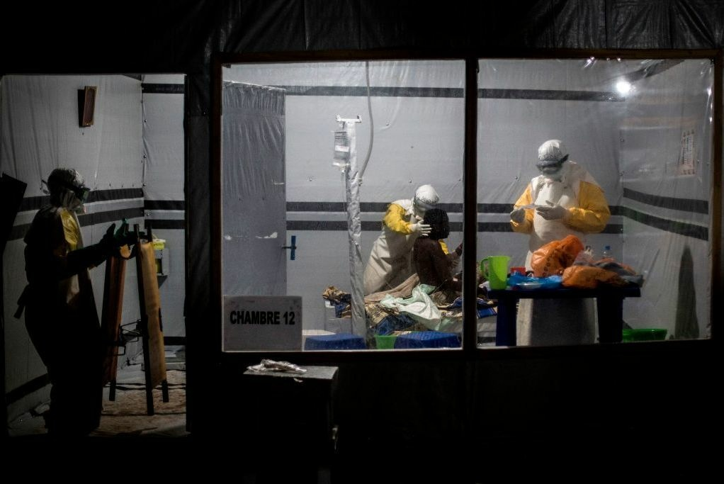 Health workers treat a patient at the Ebola Treatment Center in the city of Butembo. It's one of three locations where researchers have been conducting a clinical trial of four experimental treatments for the disease.