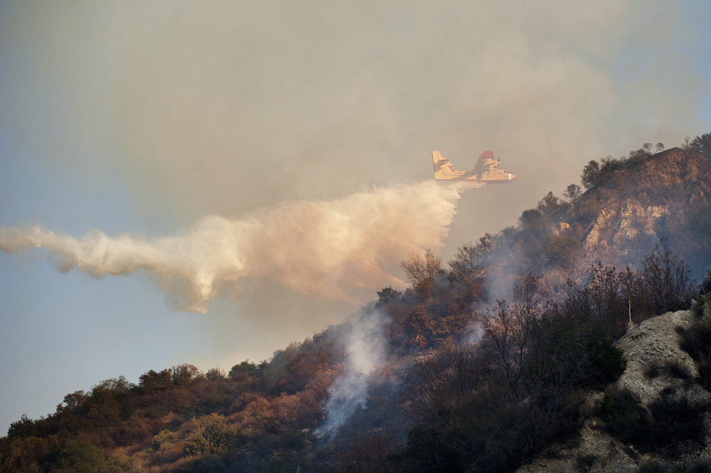 A drop is made near Route 39 on Thursday afternoon. The Colby Fire is 30 percent contained and has burned 1,700 acres in the mountains near Glendora according to LA County Fire.