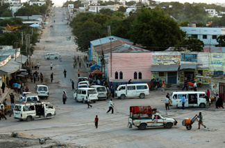 "A view of the strategic junction in town, known as ""Kilometer 4."" While Mogadishu is very dangerous, bullets aren't flying all the time, and when things are calm people are often out and about shopping and chatting."