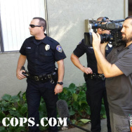 "A ""COPS"" crew on location with police officers."