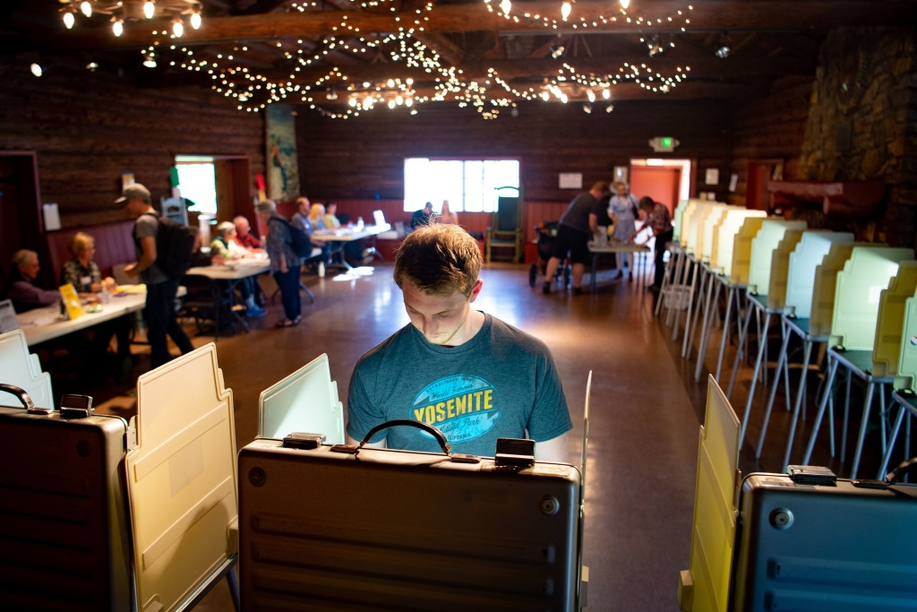 Voters fill out their ballots for the presidential primary in a log cabin run by the American Legion in San Anselmo, Calif., on Super Tuesday, March 3, 2020. While no significant foreign interference was detected, election and law enforcement officials are closely monitoring this year's primaries.