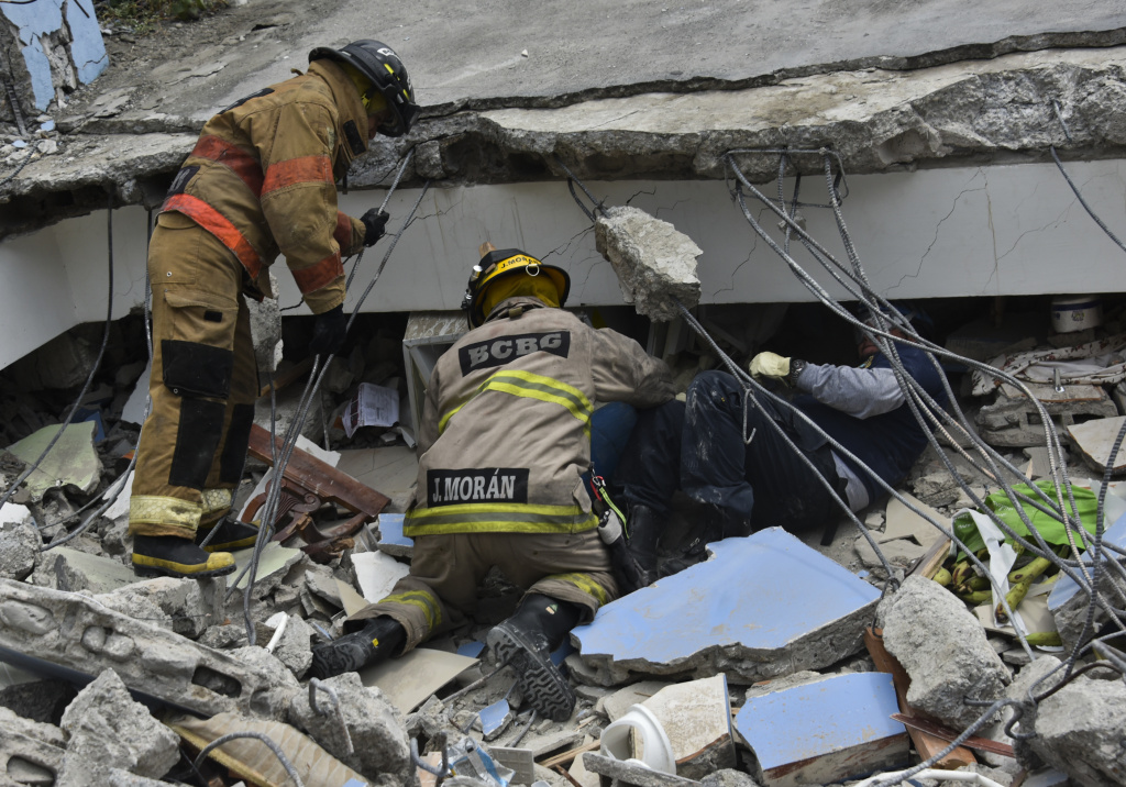 Rescue workers search the rubble after a 7.8-magnitude quake in Gauyaquil, Ecuador on April 17.