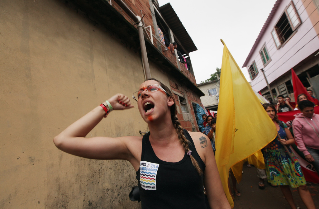 Protesters march through the decades-old Vila Autodromo squatter settlement before demonstrating outside an entrance to the Rio + 20 conference on June 20, 2012 in Rio de Janeiro, Brazil.