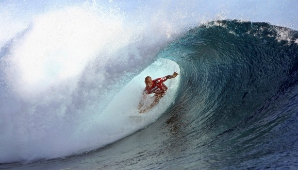 Surfer Kelly Slater rides a wave.