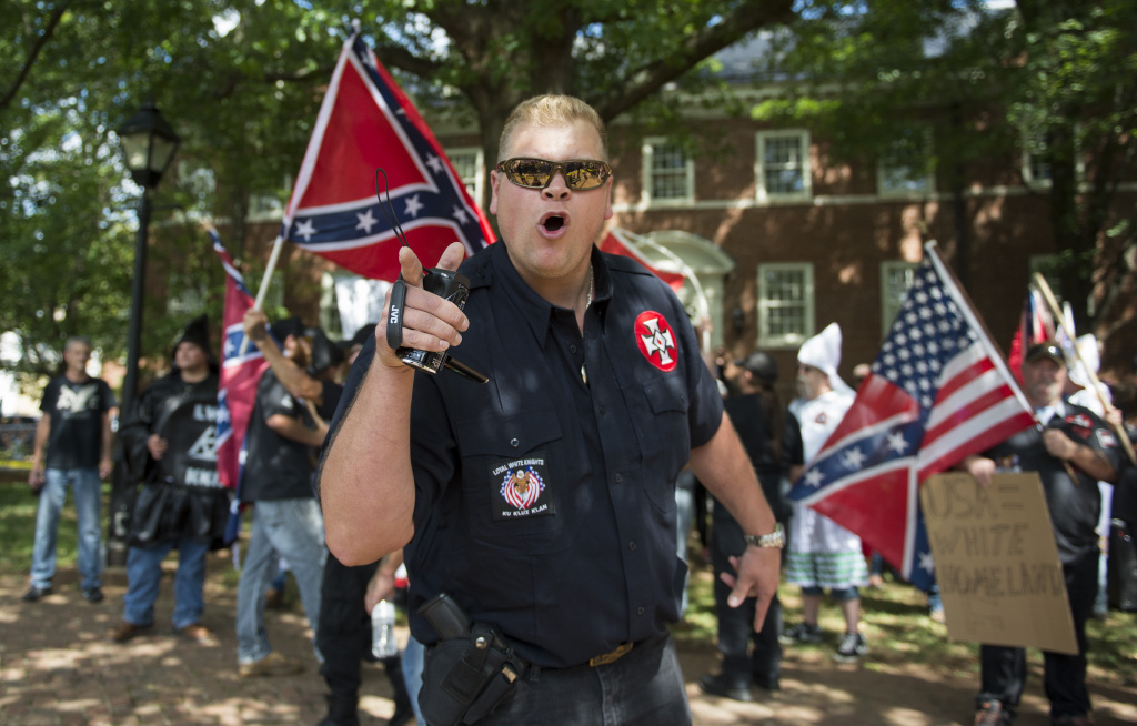 A member of the Ku Klux Klan shouts at counter protesters during a rally, calling for the protection of Southern Confederate monuments, in Charlottesville, Virginia on July 8, 2017.