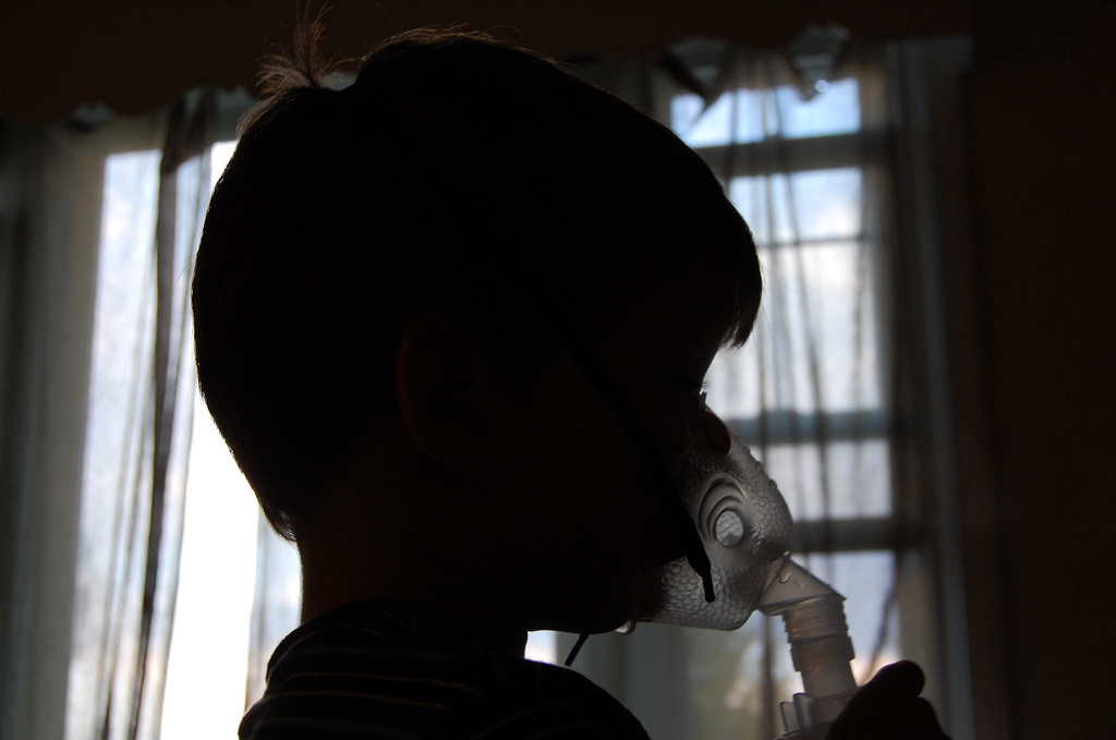 A child with severe asthma uses a respirator to breathe.