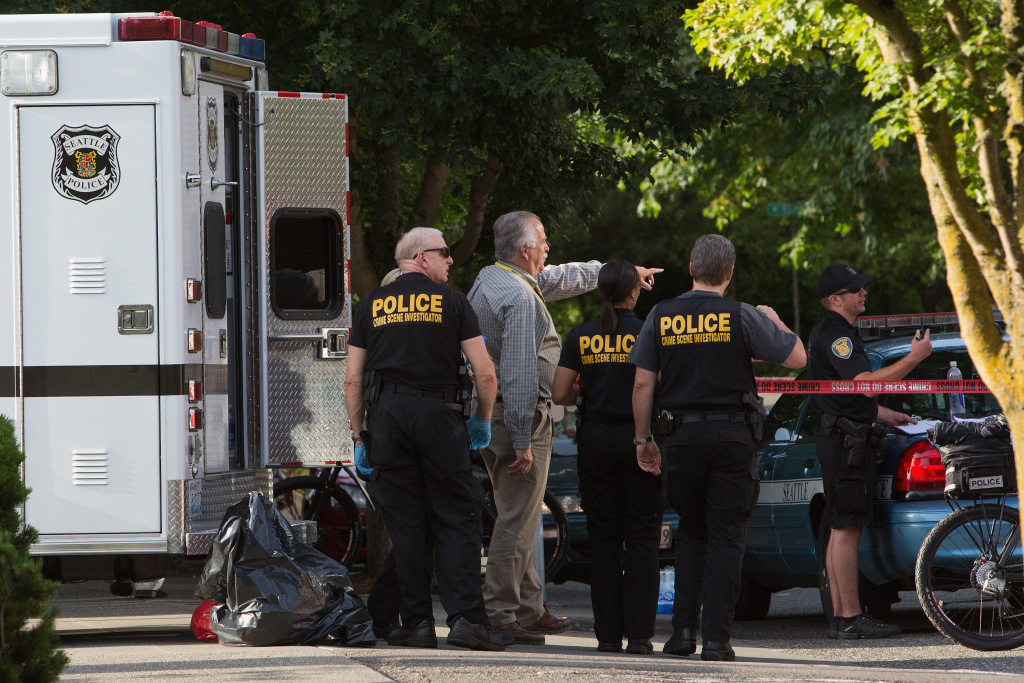 Seattle Police officers secure the crime scene after a shooting at Seattle Pacific University on June 5, 2014 in Seattle, Washington.  A gunman is in custody after four people were shot on campus resulting in one death.