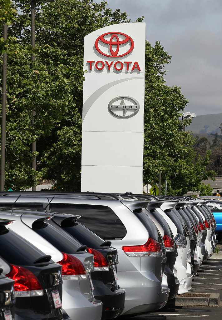 Brand new Toyota cars are displayed on the sales lot at Toyota Marin. Toyota Motor Corp. reported a 75 percent decline in quarterly profits with earnings of 25.4 billion yen ($314 million) compared to 112.2 billion yen a year earlier.