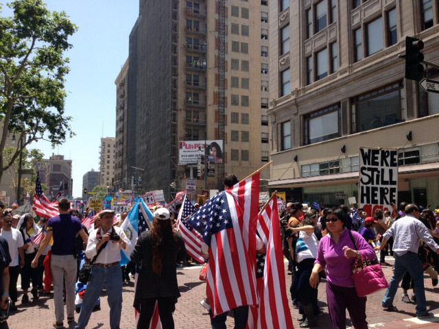 Immigrant advocates filed a lawsuit in Los Angeles Wednesday alleging that immigration agents are filing paperwork to keep arrestees in custody longer without investigating whether they're in the country illegally. (Photo: Immigration protesters take to the streets of Los Angeles for a May Day rally march, May 1, 2013.)