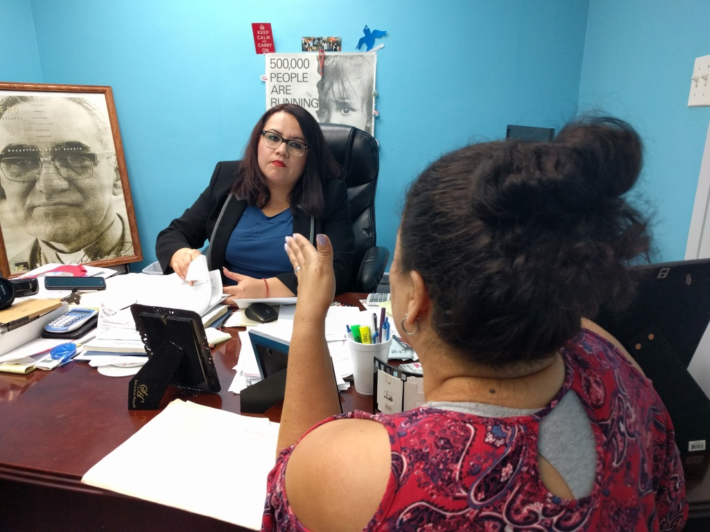 Immigration lawyer Yanci Montes advises a client at El Rescate, a non-profit that provides free legal services to immigrants in Pico-Union.